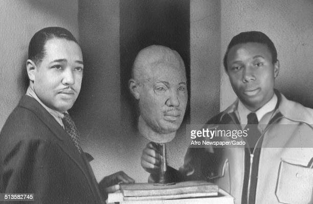 AfricanAmerican composer pianist bandleader and Jazz musician Duke Ellington with a carved bust standing July 1941