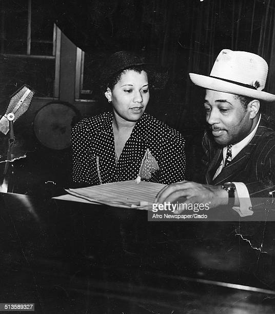AfricanAmerican composer pianist bandleader and Jazz musician Duke Ellington and Jean Eldridge in a recording studio August 6 1938