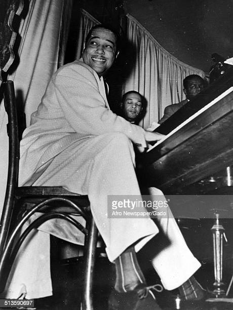 AfricanAmerican composer pianist bandleader and Jazz musician Duke Ellington playing the piano 1960