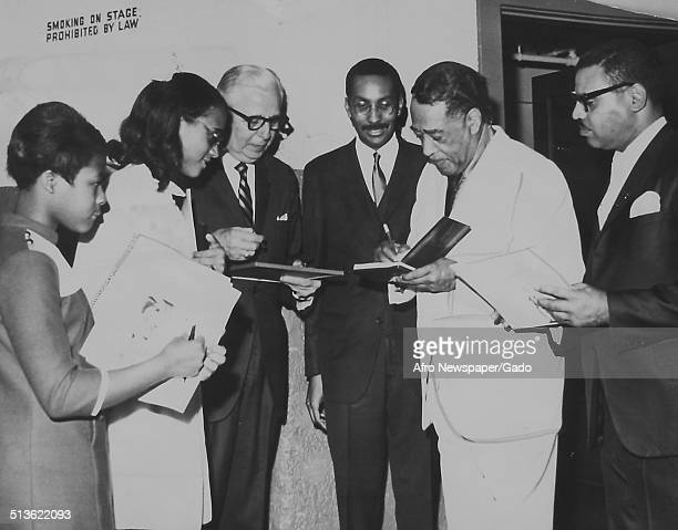 AfricanAmerican composer pianist bandleader and Jazz musician Duke Ellington signing autographs at Mosque Theater Richmond Virginia November 16 1968