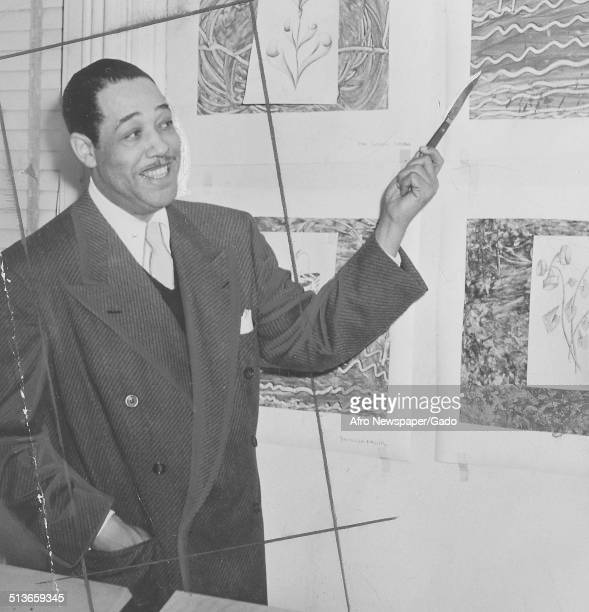 AfricanAmerican composer pianist bandleader and Jazz musician Duke Ellington with a painting at Letcher School of the Arts 1960