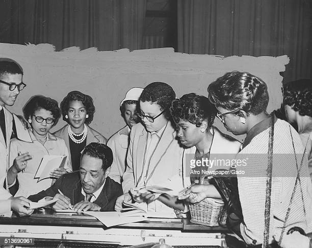 AfricanAmerican composer pianist bandleader and Jazz musician Duke Ellington and college students playing the piano May 1958
