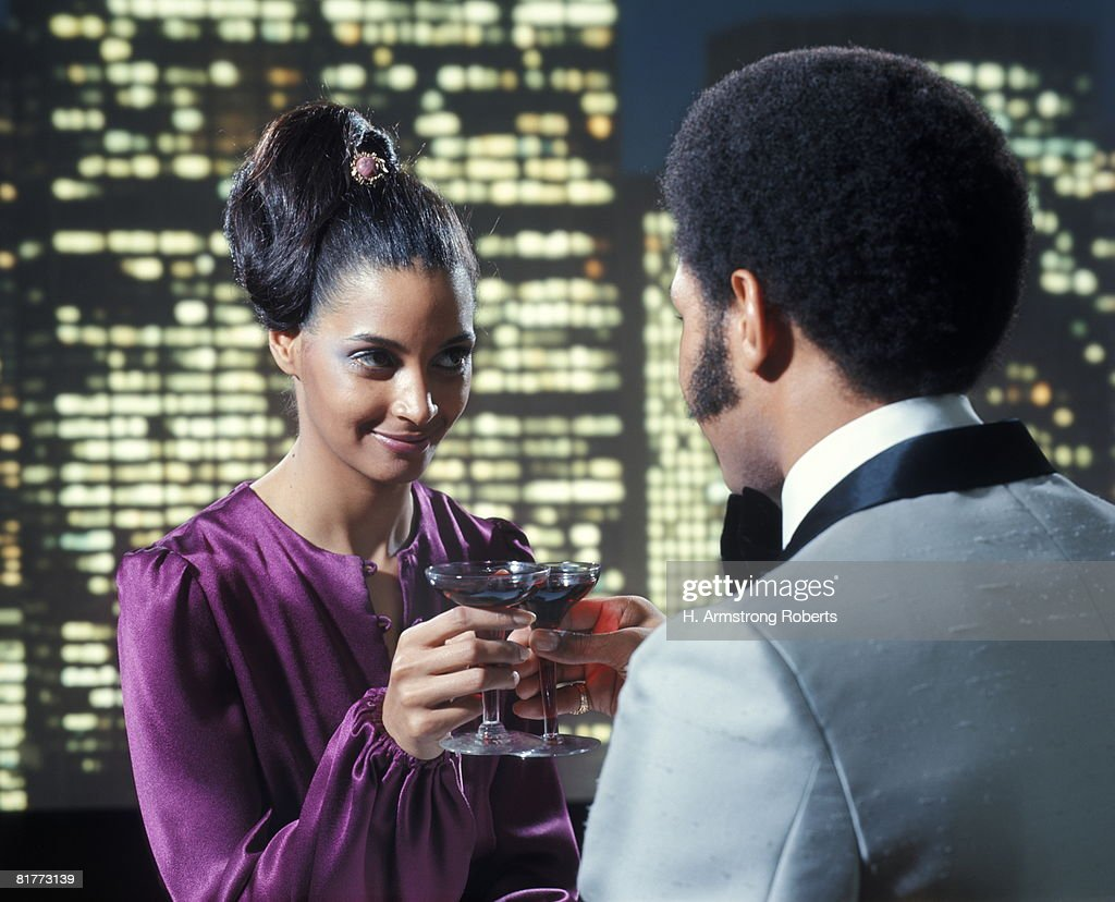 African-American Couple Man Woman Toasting Wine Glasses Romance Night Skyline Dress Fashion Sideburns. : Stock Photo