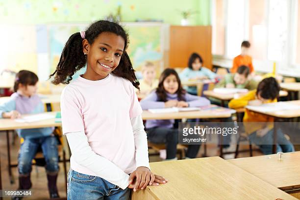 African-American girl standing in the classroom.