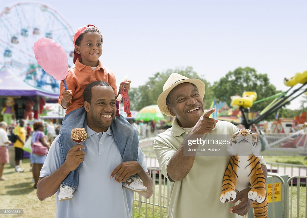 African-American grandfather with son and grandson at the fair