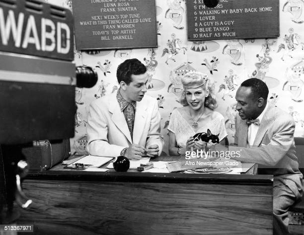 AfricanAmerican jazz vibraphonist pianist percussionist bandleader and actor Lionel Hampton Bill Silbert and Gladys Shelly during a radio show 1955