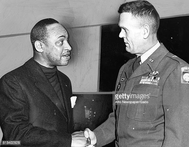 AfricanAmerican jazz vibraphonist pianist percussionist bandleader and actor Lionel Hampton and United States Army commander Thomas F Shurnurne...