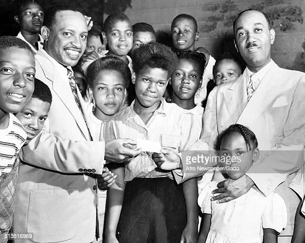AfricanAmerican jazz vibraphonist pianist percussionist bandleader and actor Lionel Hampton African American youth and a girl 1955