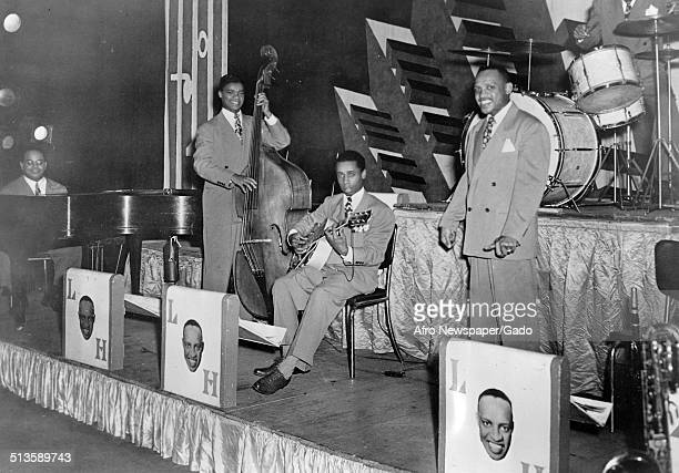 AfricanAmerican jazz vibraphonist pianist percussionist bandleader and actor Lionel Hampton a Jazz orchestra and men playing 1955