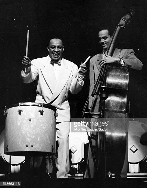 AfricanAmerican jazz vibraphonist pianist percussionist bandleader and actor Lionel Hampton and men playing February 1947