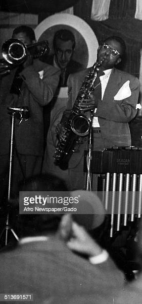 AfricanAmerican jazz vibraphonist pianist percussionist bandleader and actor Lionel Hampton and a Jazz orchestra 1957