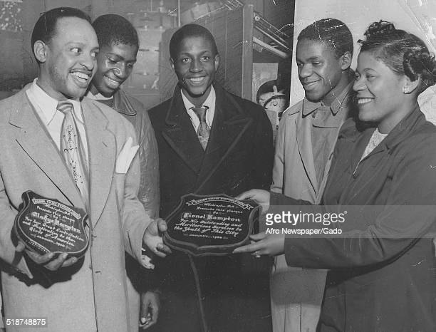 AfricanAmerican jazz vibraphonist pianist percussionist bandleader and actor Lionel Hampton receiving an award Washington DC October 28 1950