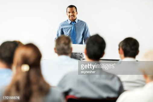 African-American man having a public speech.
