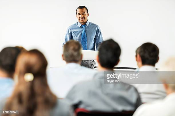 African-American man having a public speech.