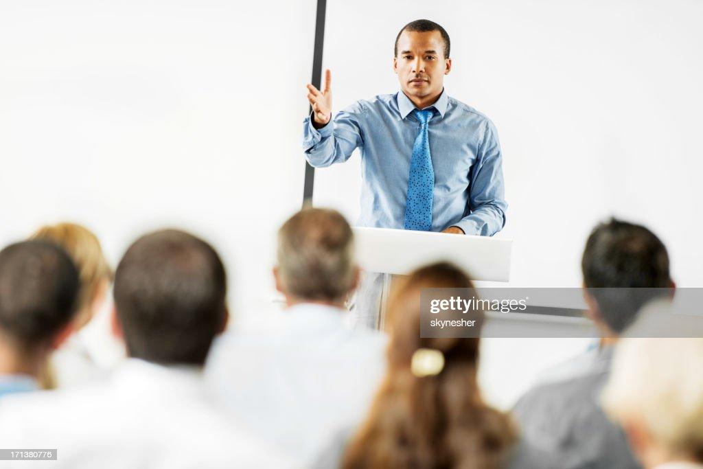 African-American man having a public speech. : Stock Photo