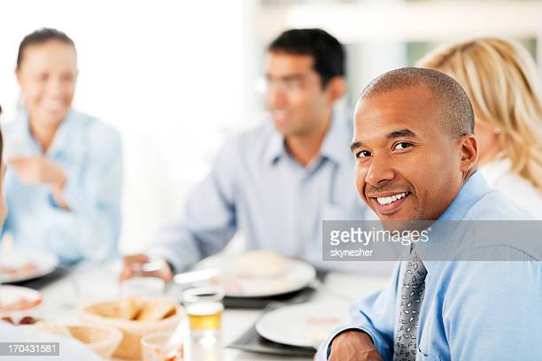 African-American man turning towards the camera in a restaurant.