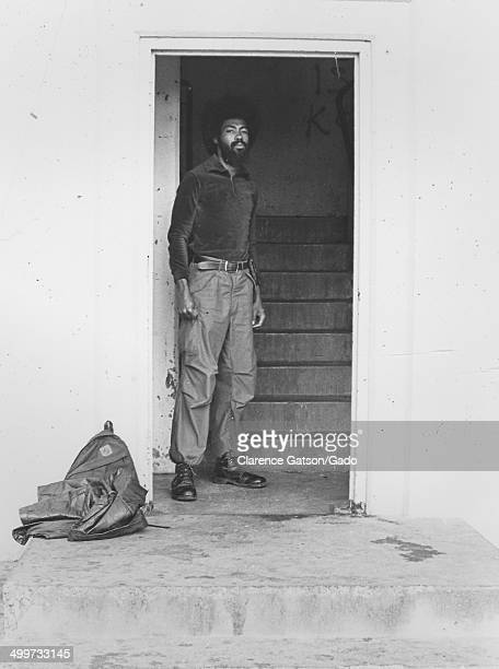 AfricanAmerican man wearing army boots and Afro haircut posing in a doorway San Francisco California 1980