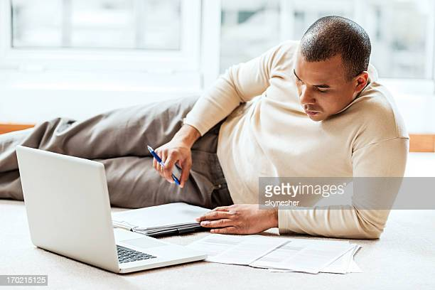 African-American man working at home.