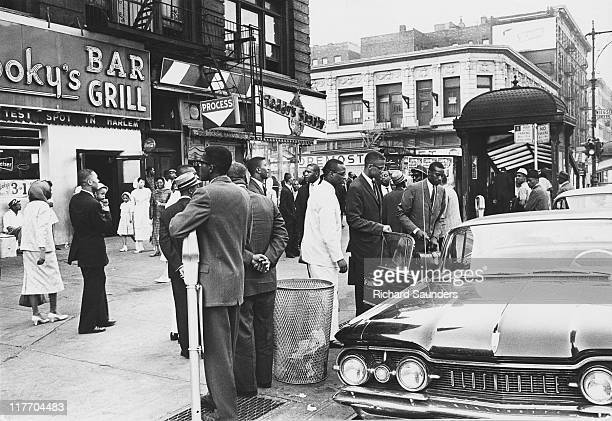 AfricanAmerican Muslim minister and civil rights activist Malcolm X getting into a car outside Temple 7 a Halal restaurant patronized by black...