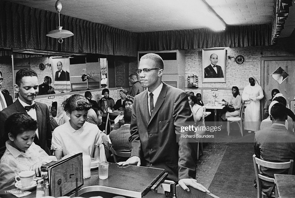 AfricanAmerican Muslim minister and civil rights activist Malcolm X at Temple 7 a Halal restaurant patronized by black Muslims on Lenox Avenue and...