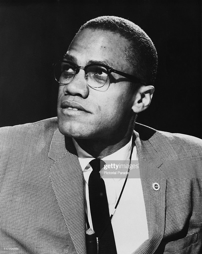 AfricanAmerican Muslim minister and civil rights activist Malcolm X appearing on a round table discussion edition of the PBS programme 'Open Mind'...