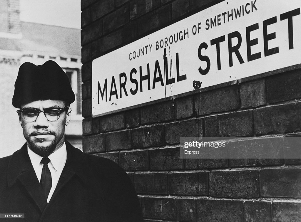 AfricanAmerican Muslim minister and civil rights activist Malcolm X on Marshall Street in Smethwick near Birmingham 12th February 1965 The local...