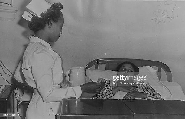 AfricanAmerican patient and nurse at a hospital Richmond Virginia 1949