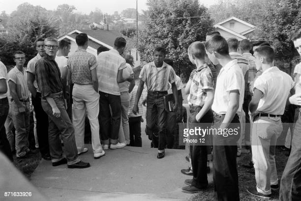 Africanamerican student is jeered as he tries to enter school in Clinton Tennasee USA during the school integration conflicts 1956