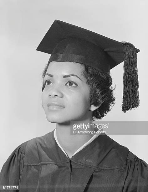 African-American woman in cap and gown, portrait.