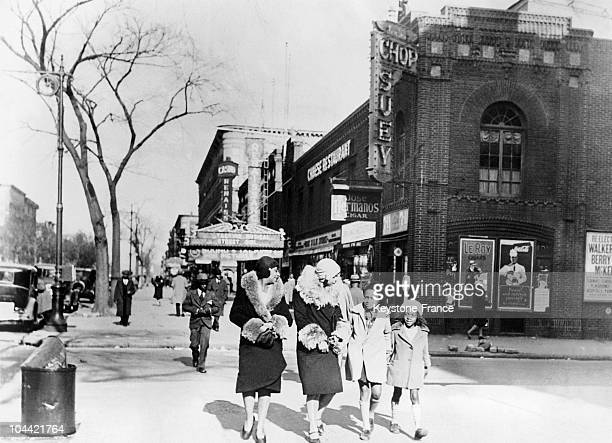 AfricanAmerican Women Walking In The District Of Harlem In 1933