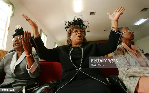 AfricanAmerican worshippers sing during services at New Macedonia Baptist Church October 31 2004 in Riviera Beach Florida The church bused voters to...