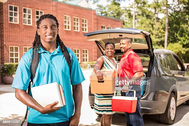 African-descent boy moves into college dorm.