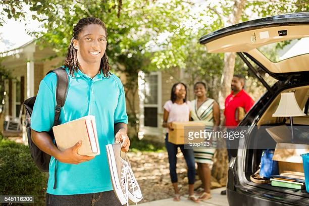 African-descent boy moves off to college.  Packed car, family.  Home.