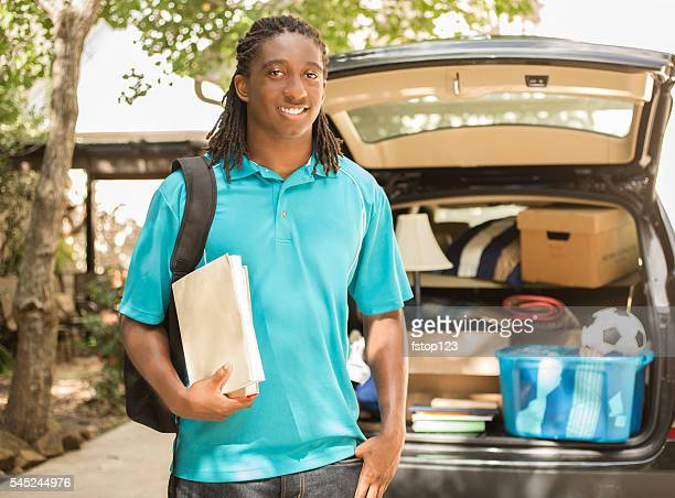 African-descent boy moves off to college.  Packed car, home.