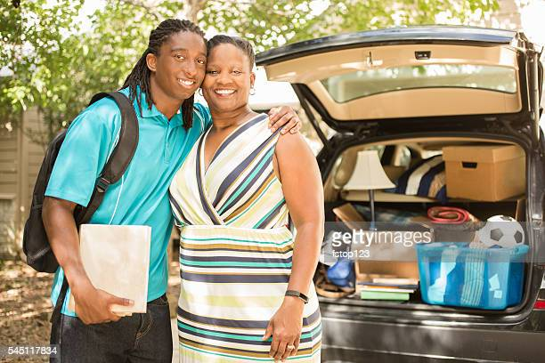 African-descent boy moves off to college.  Packed car, mom. Home.