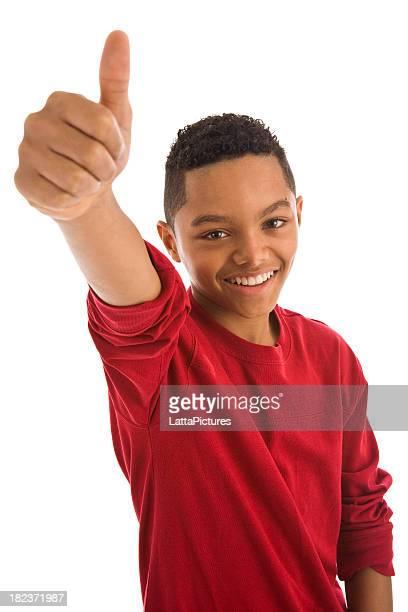 Africian ethnicity teenage boy gesturing thumbs up
