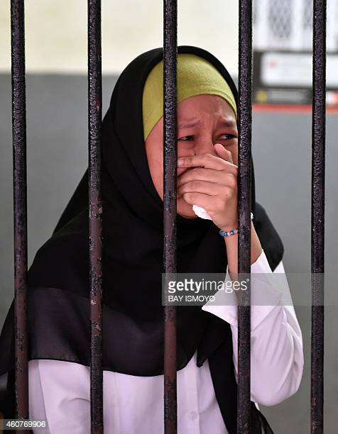Afrischa Setyani the only female cleaner among five defendants reacts after judges sentenced her to seven years in jail in Jakarta on December 22...