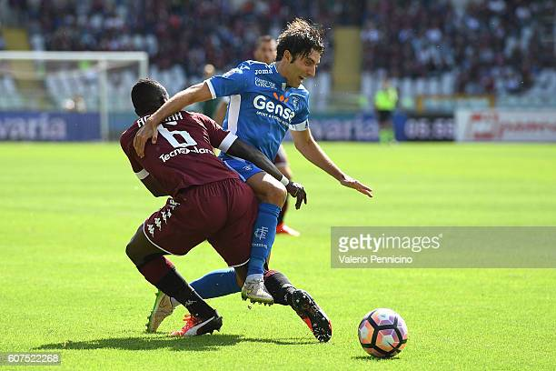 Afriyie Acquah of FC Torino competes with Daniele Croce of Empoli FC during the Serie A match between FC Torino and Empoli FC at Stadio Olimpico di...
