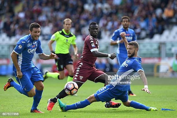 Afriyie Acquah of FC Torino in action against Andrea Costa and Manuel Pasqual of Empoli FC during the Serie A match between FC Torino and Empoli FC...