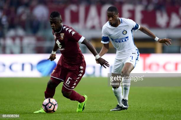Afriyie Acquah of Torino FC and Geoffrey Kondogbia of FC Internazionale compete for the ball during the Serie A football match between Torino FC and...