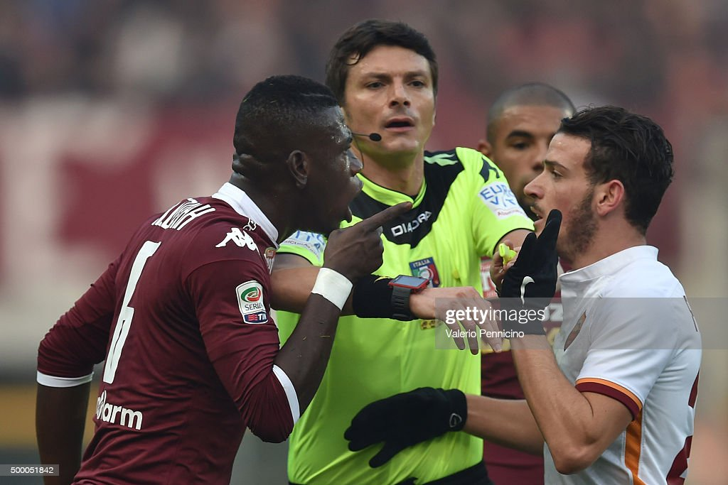Afriyie Acquah of Torino FC argues with Alessandro Florenzi of AS Roma during the Serie A match between Torino FC and AS Roma at Stadio Olimpico di...