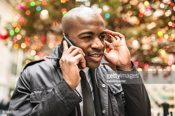 afro american business man with christmas tree