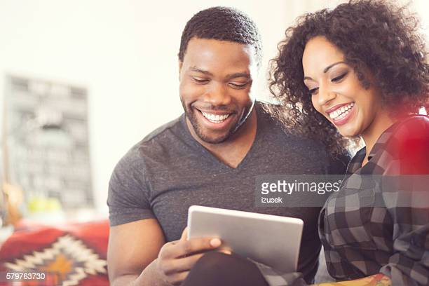 Afro american couple using a digital tablet at home