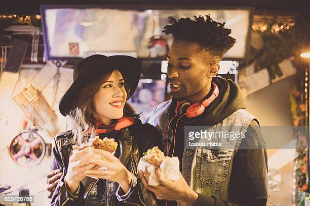 Afro american guy with his girlfriend in burger pub