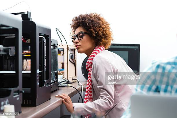 Afro american woman in 3D printer office