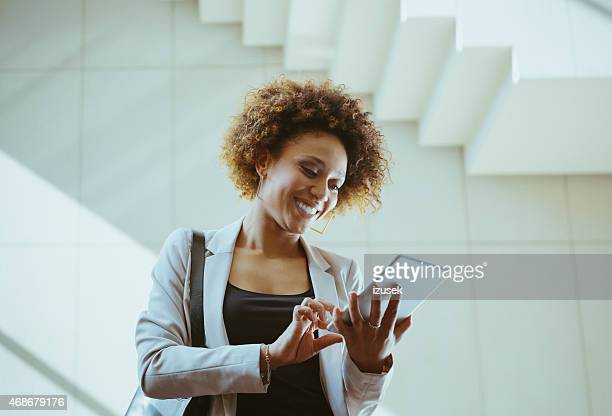 Afro american woman using a digital tablet