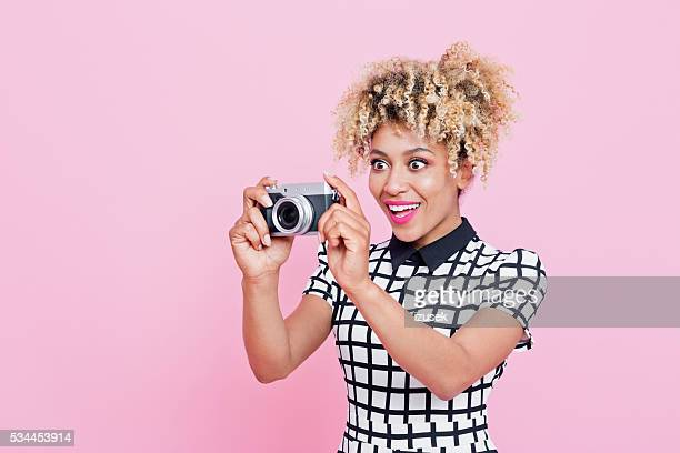 Afro American young woman holding camera