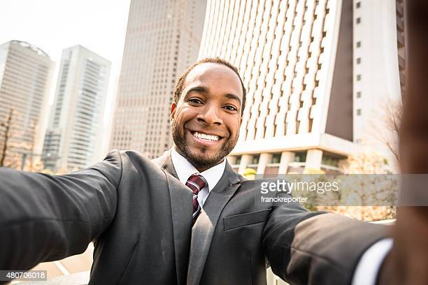 Afro Business Mann Nehmen Sie an der Tokyo