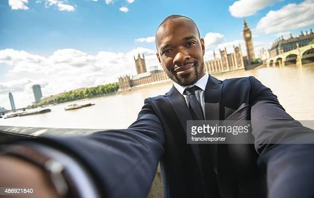 Afro Business Mann nehmen selfie in London