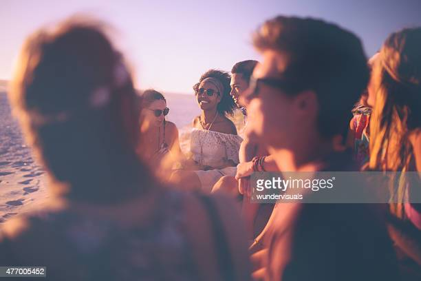 Afro girl enjoying an evening beachparty with her friends